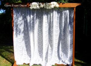 2m freestanding wooden arch for wedding ceremony with lace curtain and orchid swag for DIY hire