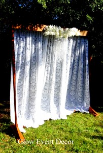 2m freestanding wooden arch for wedding ceremony with lace curtain and orchid swag and chandelier for DIY hire