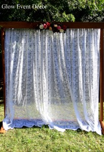 2m freestanding wooden arch for wedding ceremony with lace curtain and flower swag for DIY hire