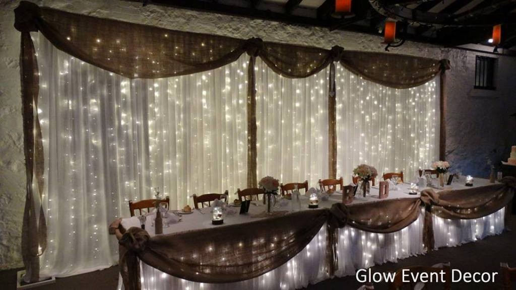 Backdrops glow event decor rustic led twinkle fairy light bridal table wedding backdrop with hessian swagging draping for hire in junglespirit Image collections