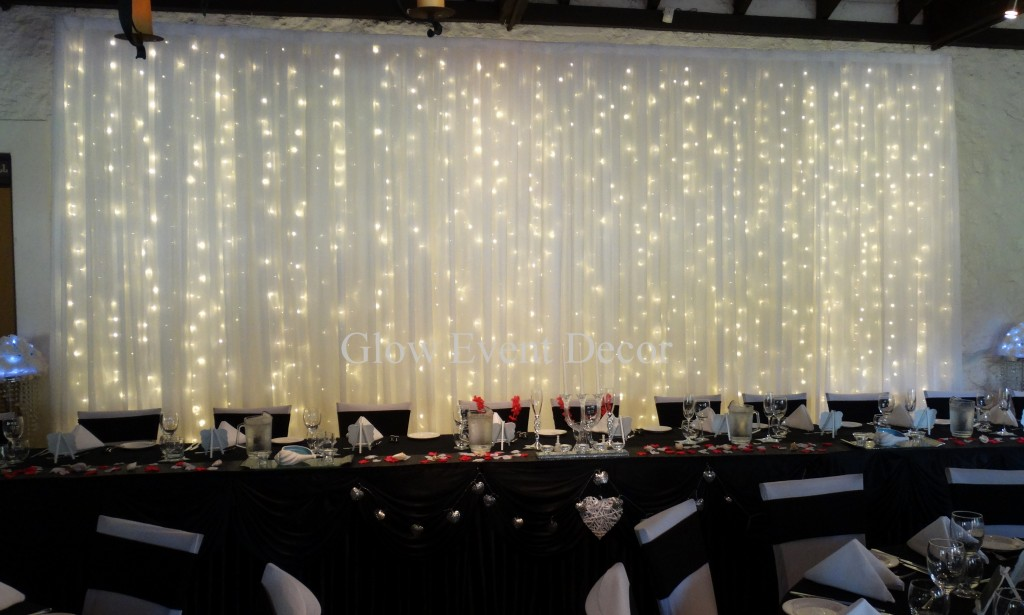 Fairy Twinkle Light Backdrop with Scalloped black bridal table skirting for wedding decorations for hire in Adelaide Glow Event Decor