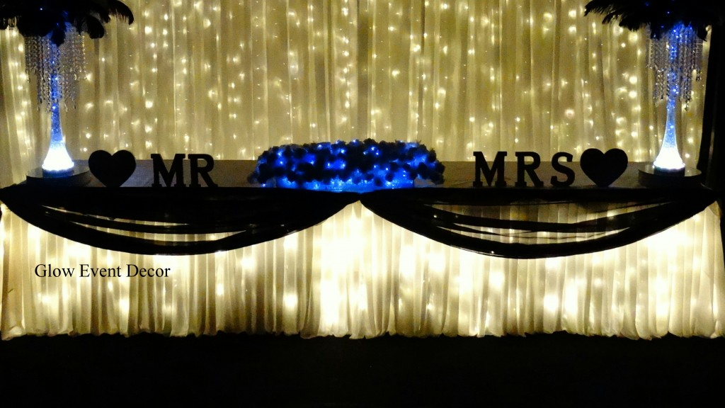 LED fairy twinkle light bridal wedding table skirting with swagging draping for wedding function party event hire from Glow Event Decor Adelaide