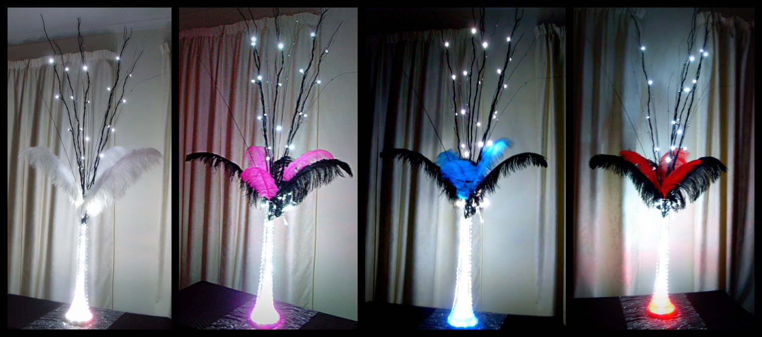 Ostrich feather table centrepiece decorations with extra tall LED branches & LED light base for hire from Glow Event Decor