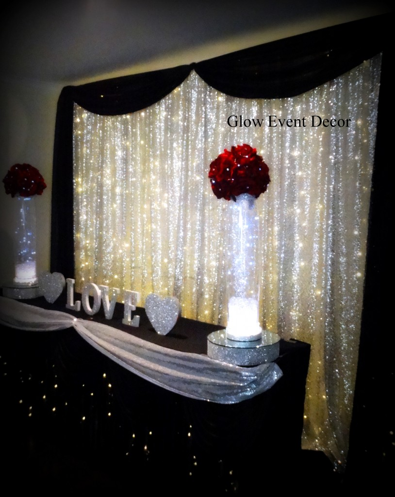 Silver sequin twinkle fairy light bridal wedding table backdrop with black swagging draping and LED fairy light twinkle light up wedding bridal table skirting for hire Adelaide Glow Event Decor