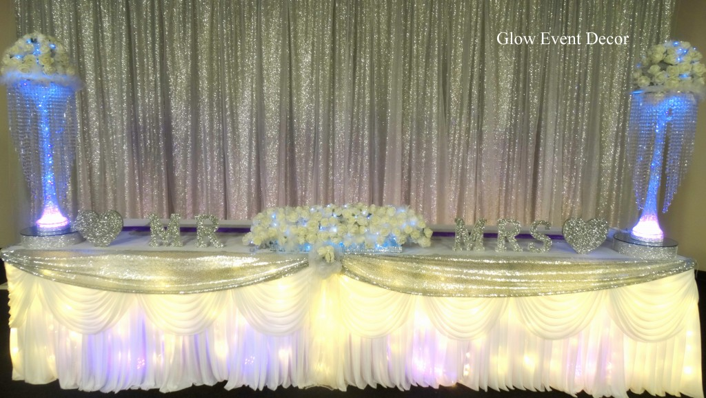 Silver sequin twinkle fairy light bridal wedding table backdrop with chiffon overlay & LED fairy light twinkle light up wedding bridal table skirting for hire Adelaide Glow Event Decor