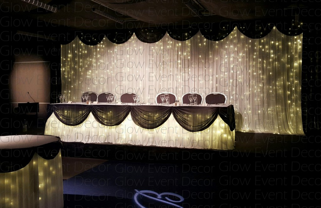 Twinkle fairy light bridal wedding backdrop with black swagging draping with matching twinkle fairy light bridal and cake table with black swagging draping for hire Glow Event Decor Adelaide