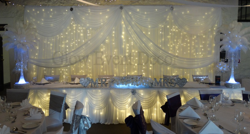Twin swag bridal backdrop with twinkle fairy lights & bridal skirting with swagging and twinkle fairy lights.