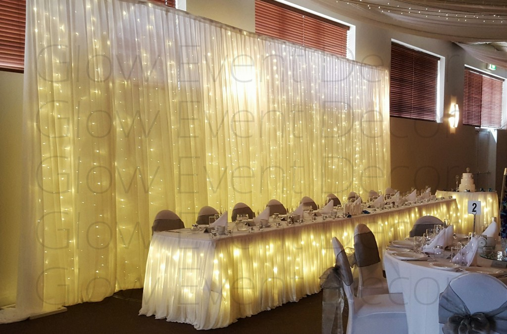 freestanding fairy light bridal table wedding backdrop with fairy light bridal wedding table skirting and matching cake table skirting, for hire Adelaide, Glow Event Decor South Australia