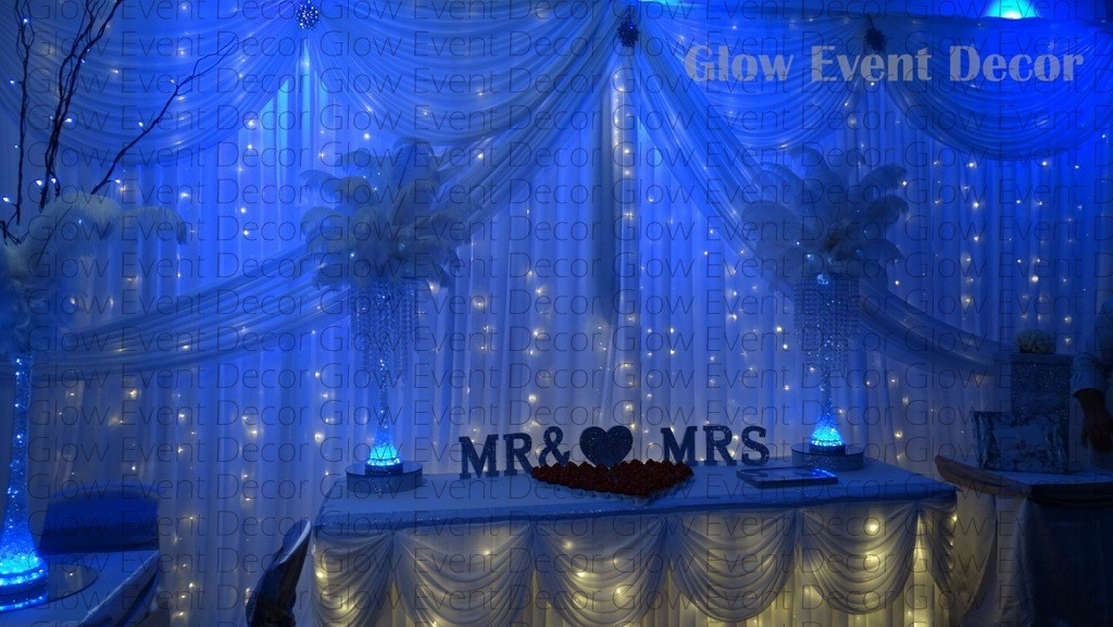 plain fairy light backdrop with purple up lighting, purple LED wall wash room uplighting, fairy light table skirt watermarked