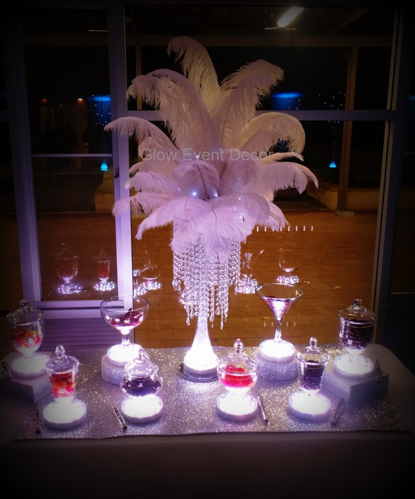 LED candy/lolly buffet with chandelier drop ostrich feather centrepiece