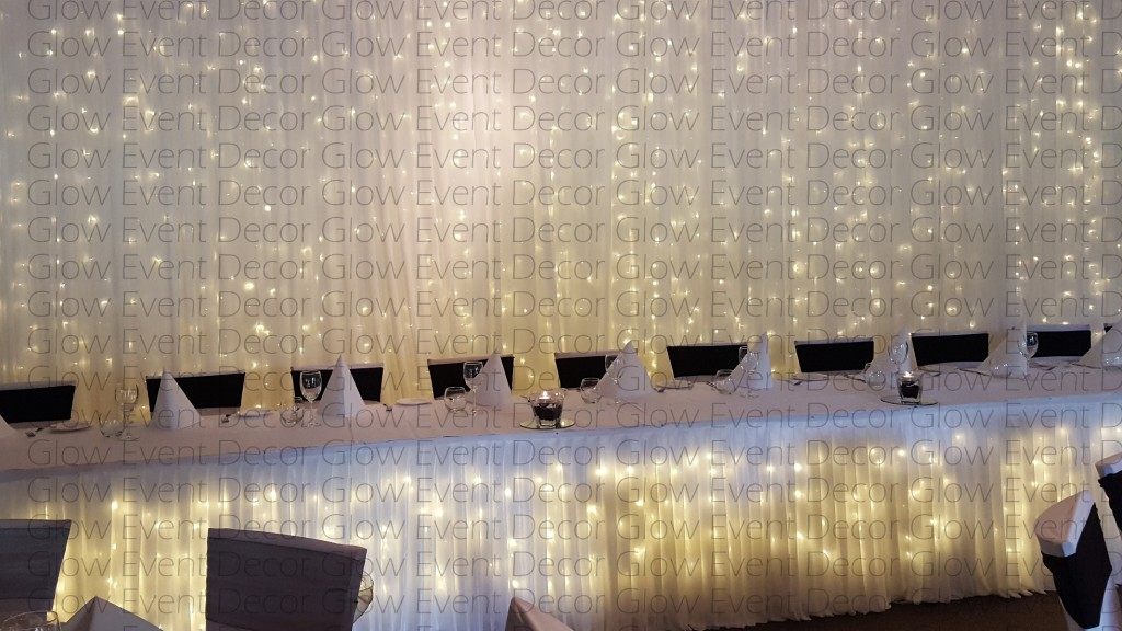 plain fairy light backdrop with matching plain fairy light bridal table skirting for hire Adelaide South Australia Glow Event Decor