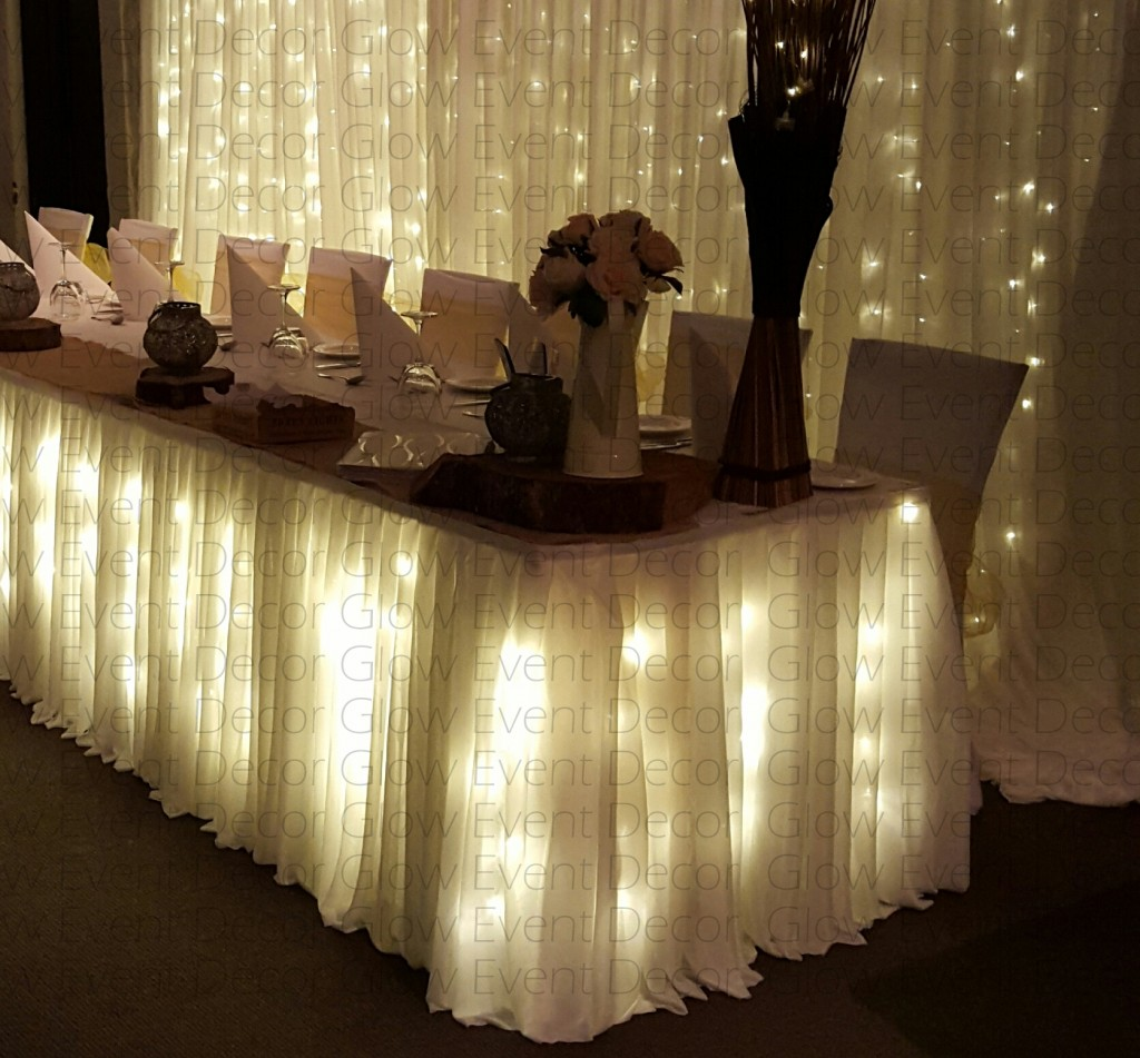 plain fairy light backdrop with plain fairy light bridal table skirting for hire Adelaide Glow Event Decor South Australia