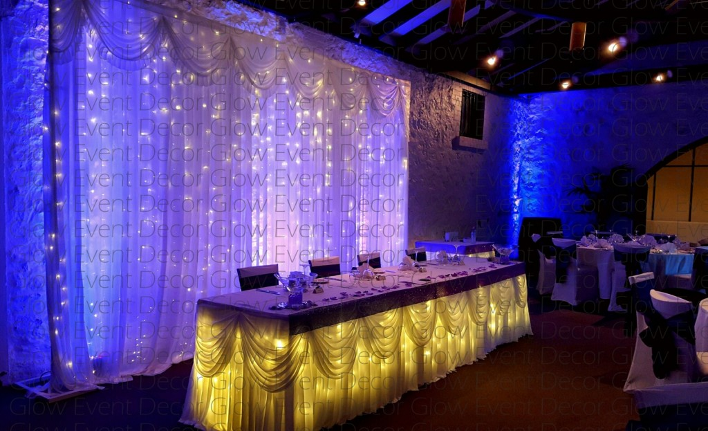 plain-fairy-light-backdrop-with-purple-wall-wash-uplighting-and-fairy-light-table-skirt