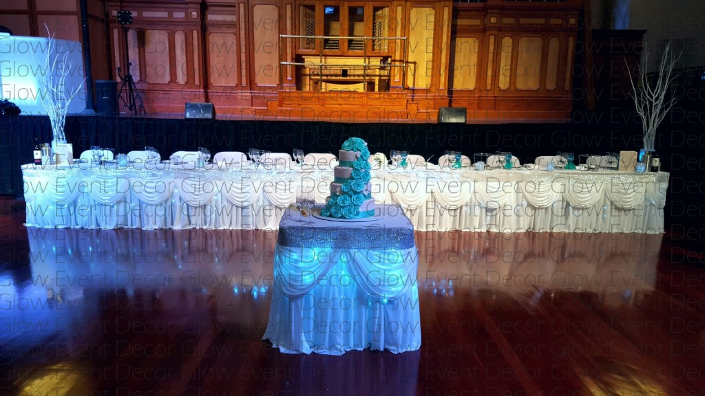 swagged fairy light wedding bridal table skirt with silver diamante trim fairy light cake table skirt Winter Wonderland Wedding for hire Adelaide, Glow Event Decor
