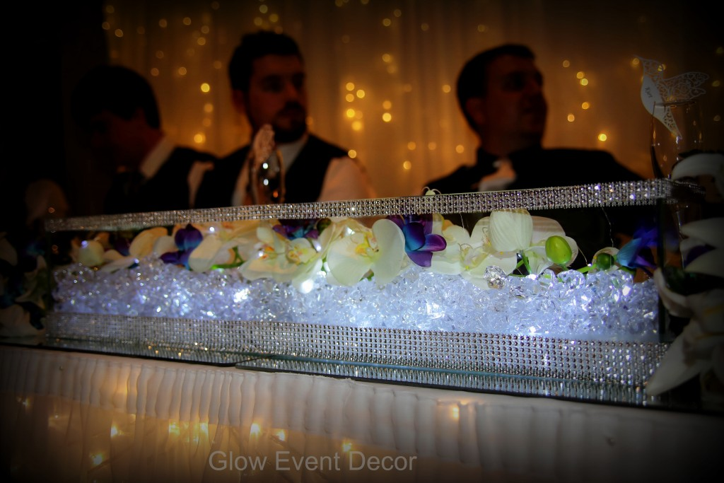 Low Line bridal table centrepiece with orchids and LED cystal lighting