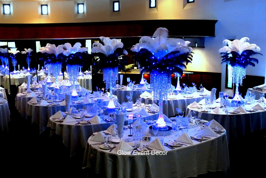 Ostrich feather LED table centrepieces with crystal chandelier drops.