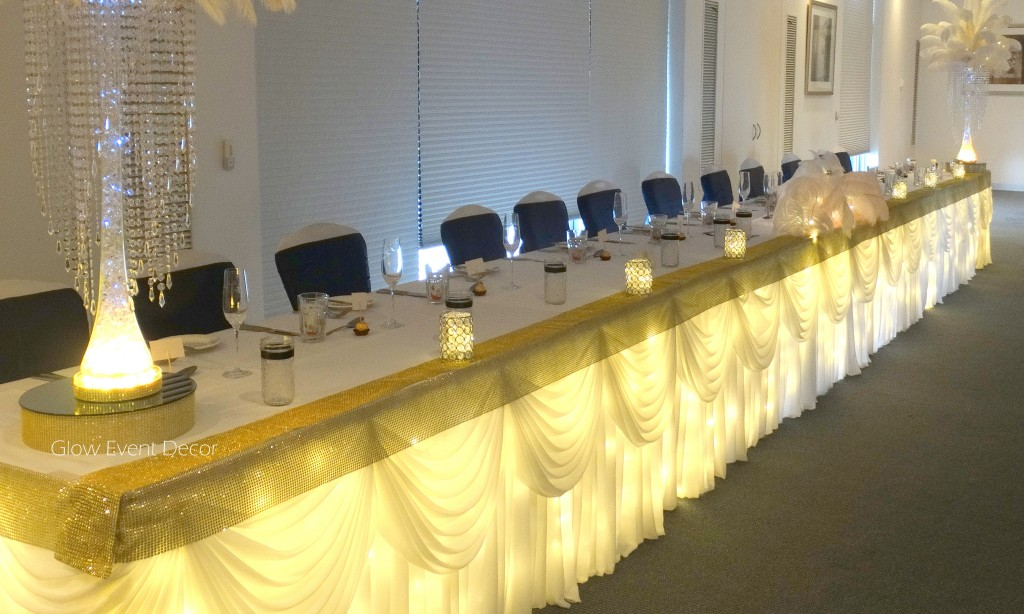 Fairy light bridal table skirting with swagging.