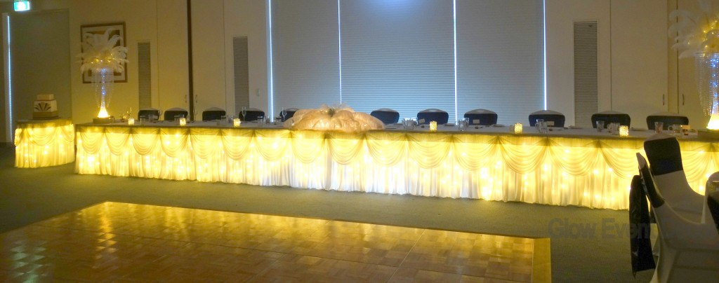 Fairy light bridal table & cake table skirting with swagging.