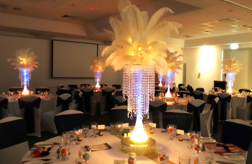 LED ostrich feather centrepieces with chandelier drops.