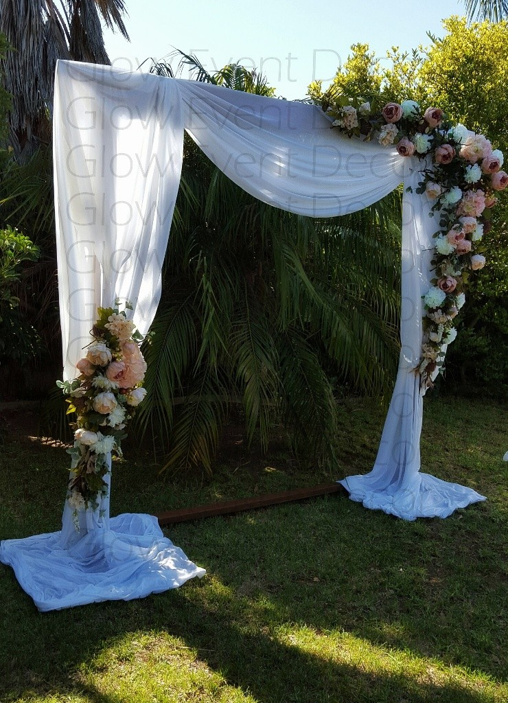2m wooden freestanding wedding ceremony arch with white draping and floral decor for DIY hire