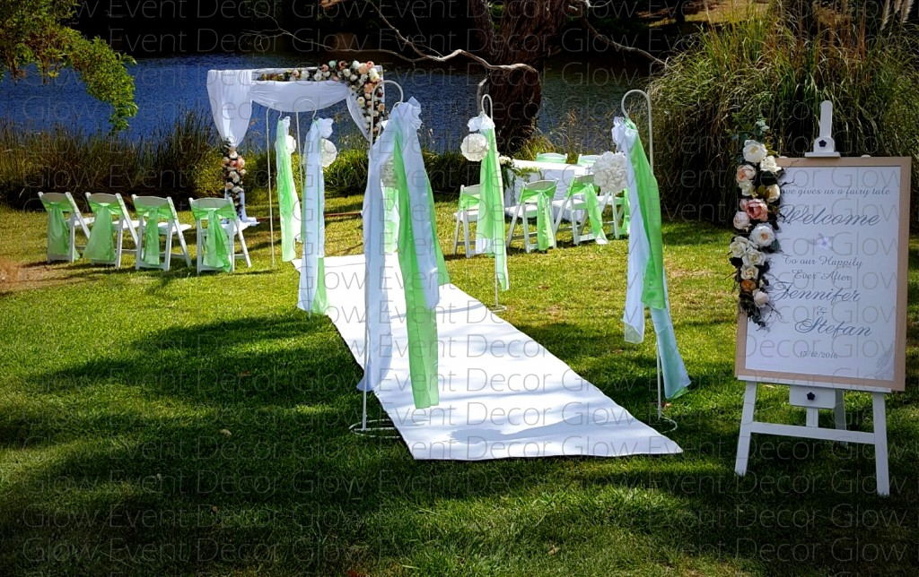 white americana chair with square wooden arch with draping and siging table for hire Glow Event Decor