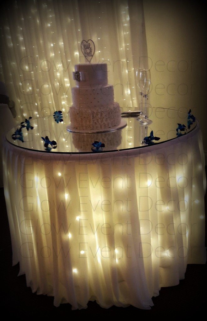Fairy light cake table skirting and Fairy Light Backdrop