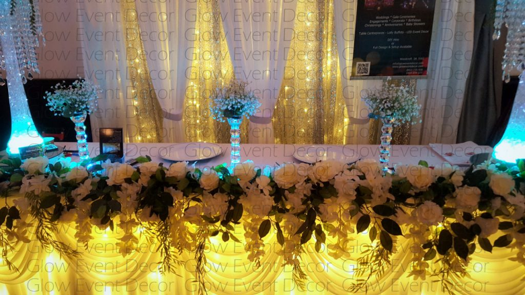fairy light bridal table skirting with botanical greenery ivy floral for hire Glow Event Decor Adelaide