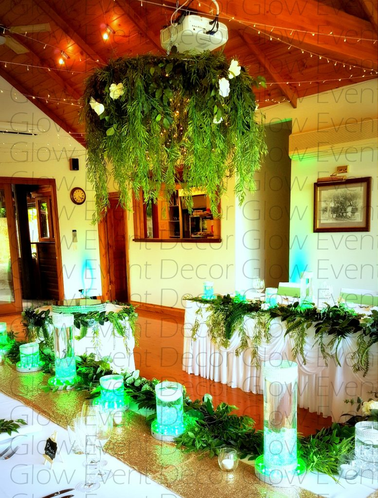 hanging greenery botanical chandelier with fairy lights for hire Glow Event Decor