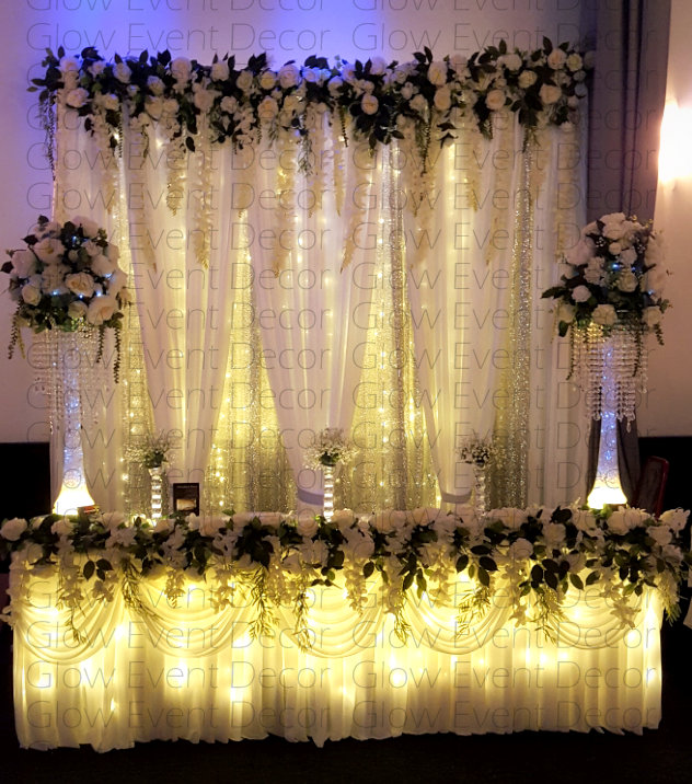 sequinned botanical fairy light wedding bridal table backdrop greenery, ivy, floral