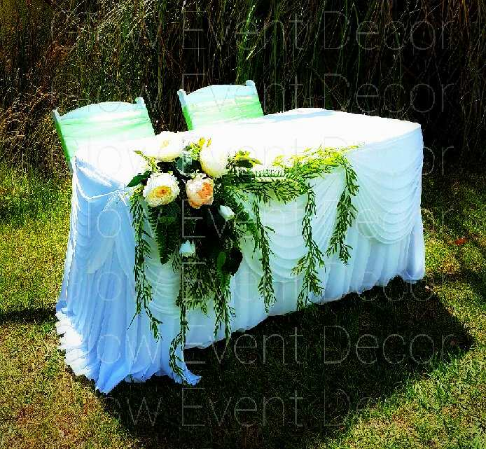 signing table with botanical swagged skirt and greenery and floral swag